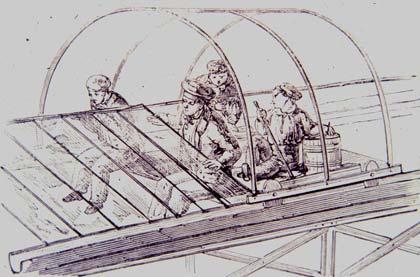Xe rùa đẩy tay có bánh xe sử dụng như máng xối làm ray vận chuyển cả người và vật liệu, giảm bớt việc bắt giàn giáo cho thợ lắp kính