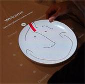 Chọn thực đơn nhà hàng bằng cách xoay đĩa chọn món