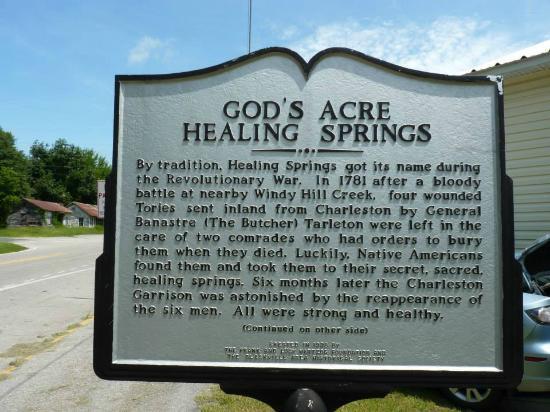 Bia giới thiệu lịch sử hình thành tại lối vào God's Acre Healing Springs.