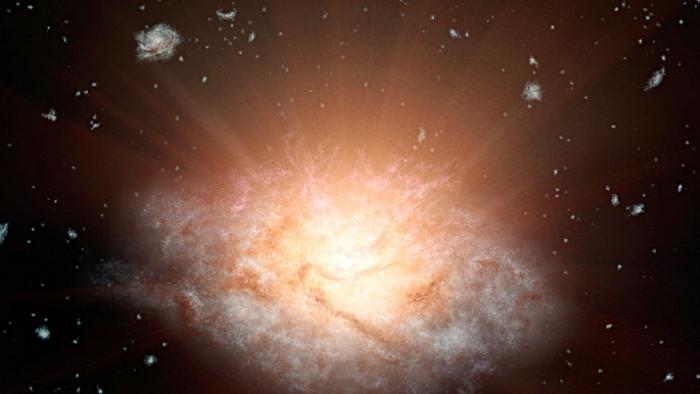 Luồng ánh sáng hồng ngoại dữ dội đang làm bốc hơi các vật chất tạo sao trong thiên hà sáng nhất vũ trụ.