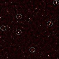 Phát hiện 9 siêu hố đen quay mặt về cùng hướng