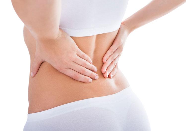 Đau lưng cũng là một trong những dấu hiệu cảnh báo ung thư buồng trứng.