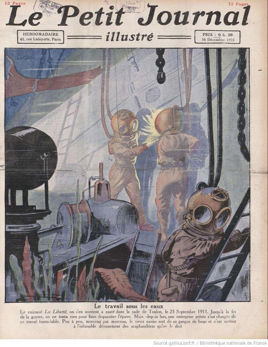 """Công nhân đang mang các thiết bị chuyên dụng rồi lặn xuống đáy biển để phục hồi, sửa chữa và """"hồi sinh"""" con tàu La Liberté, con tàu lừng danh của nước Pháp bị phát nổ và chìm xuống vịnh Toulon ở Pháp vào cuối tháng 9 năm 1911."""