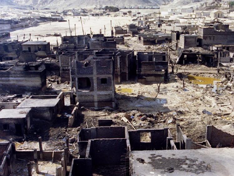 Một góc của thành phố Dronka sau khi bị nhấn chìm trong biển lửa.