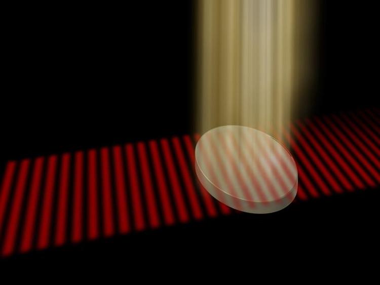Vật liệu trở nên trong suốt khi được chiếu một chùm tia laser từ phía trên.