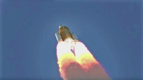 Tên lửa bắt đầu bay lên không gian mang theo con tàu vào vũ trụ.