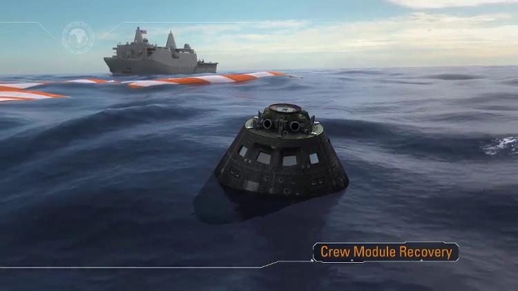 Khoang chở phi hành đoàn hạ cánh xuống mặt biển.