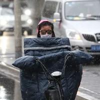 Sau 30 năm, Bắc Kinh lại đón tuyết rơi vào tháng 4