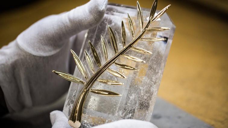 Hình ảnh cành cọ vàng được thiết kế từ năm 1998 bởi bà Caroline Scheufele – chủ tịch tập đoàn Thụy Sĩ Chopard.