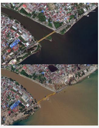 Di chuyển về phía đông, sóng thần đã phá hủy cây cầu, gây lũ lụt khu dân cư xung quanh.