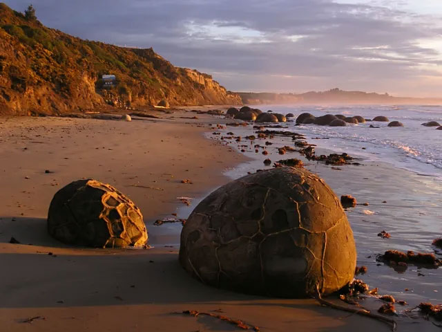 Surreal scenes such as aliens at the 'dragon egg' rock beach tens of