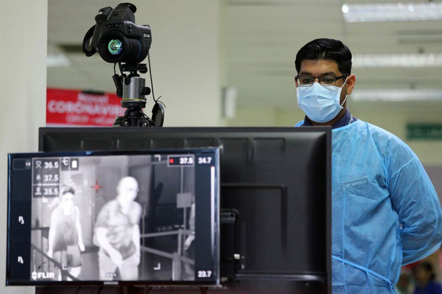 Hình ảnh kiểm tra thân nhiệt tại Malaysia.