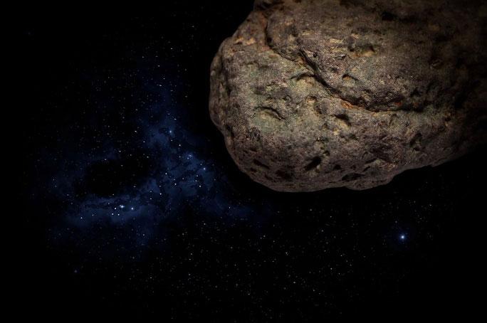 Ảnh minh họa mô tả một mảnh của hành tinh nguyên thủy giống Trái đất đang còn lang thang trong Hệ Mặt trời